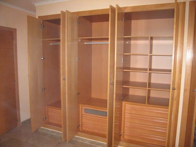 Closet hotel la puerta carpinteria for Modelos de zapateras en closet